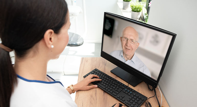Woman using computer for telemedicine appointment
