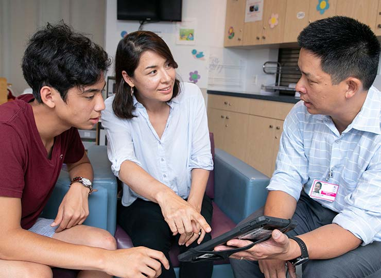 Photo of Patients talking with physician