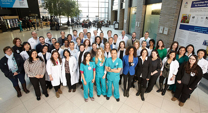 Image of doctors, staff, nurses at The Recanati/Miller Transplantation Institute in the lobby