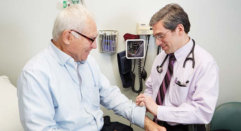 Photo of Doctor checking patient's pulse