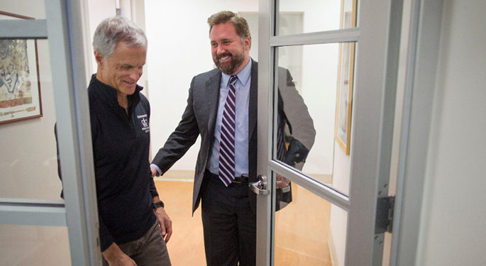 image of Dr. Mocco holding door open for patient