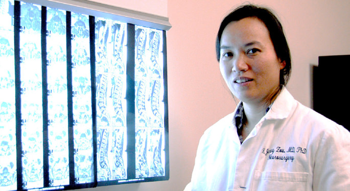 image of Dr. Zou in front of various x-rays
