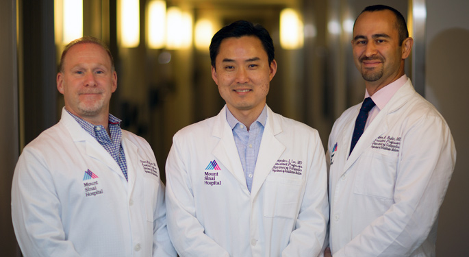 Group image of spine physiatry Drs. Eugene Bulkin, Alexander Lee, and Stuart Kahns