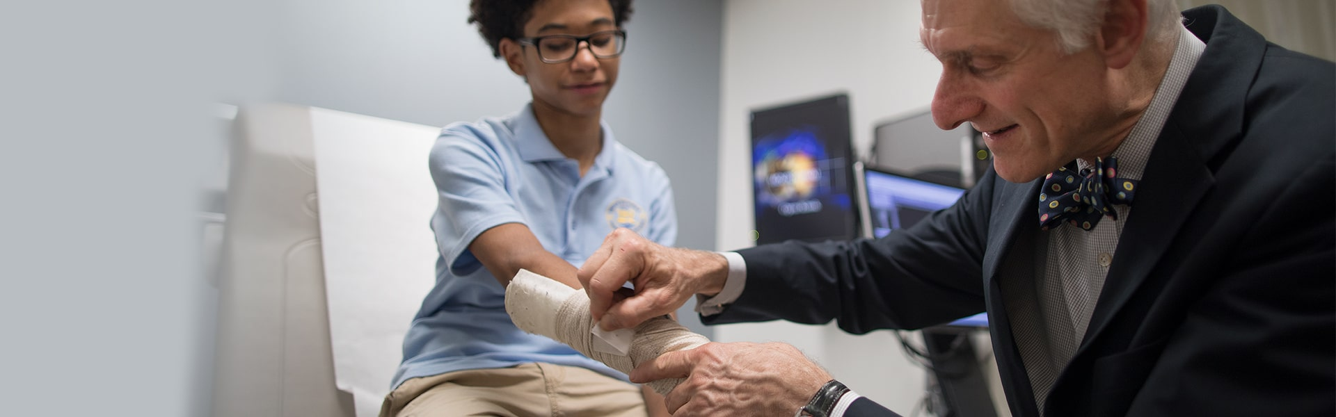 Orthopedic surgeon, Dr. Michael Hausman, with teen hand injury patient