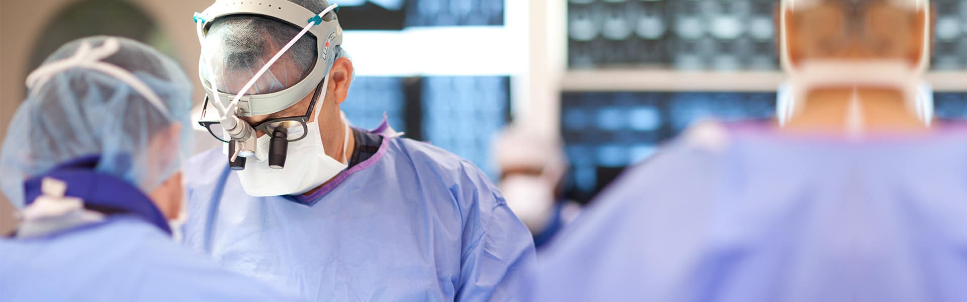Orthopedic surgeon, Andrew Hecht, performing surgical spine procedure