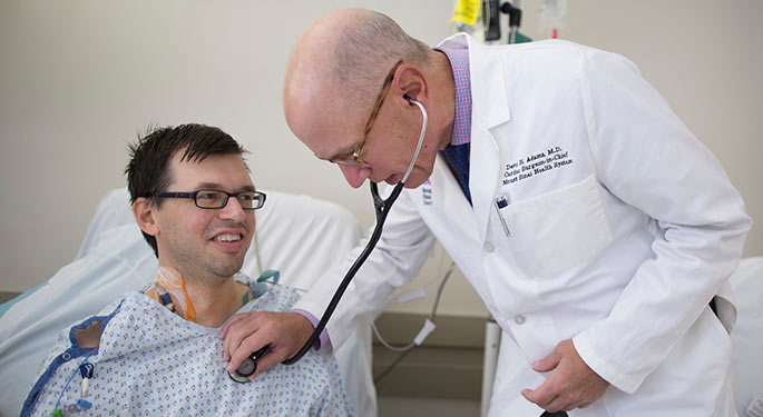 Image of Dr. David Adams with patient