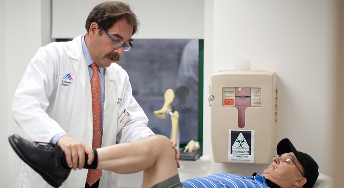 Orthopedic surgeon, Dr. Michael Bronson, with male joint replacement patient