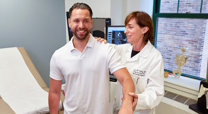 Image of orthopedic surgeon and system chair, Dr. Leesa Galatz with male shoulder patient.
